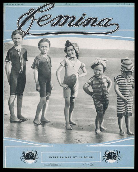 Five children pose for the camera in their beachwear