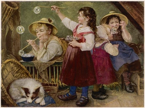 Young German children blowing bubbles