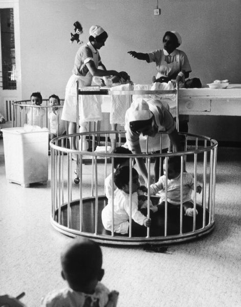 Children and nurses in a creche in Italy