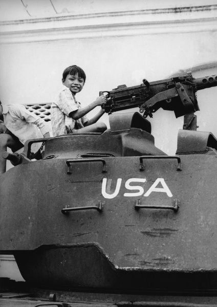Following the US pullout from Vietnam, children play on an abandoned American tank in a North Vietnam Street. *UNAVAILABLE FOR USE IN ASIA AT PRESENT*