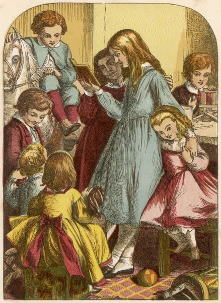A group of Victorian children listen to older girls reading a story