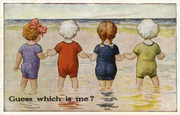 "Four children paddling in the sea: ""Guess which is me?&quot"