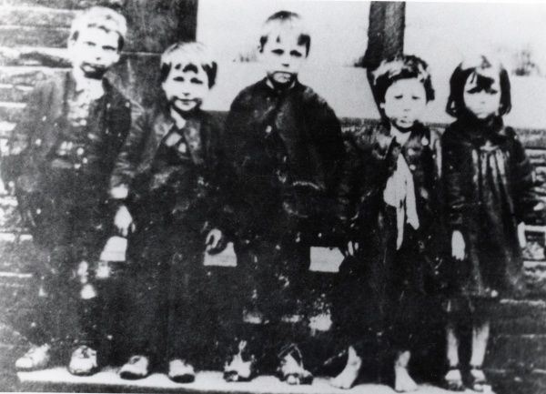 Five children, four boys and a girl, photographed in a South Wales mining district. They possibly belong to a Dr Barnardo's orphanage