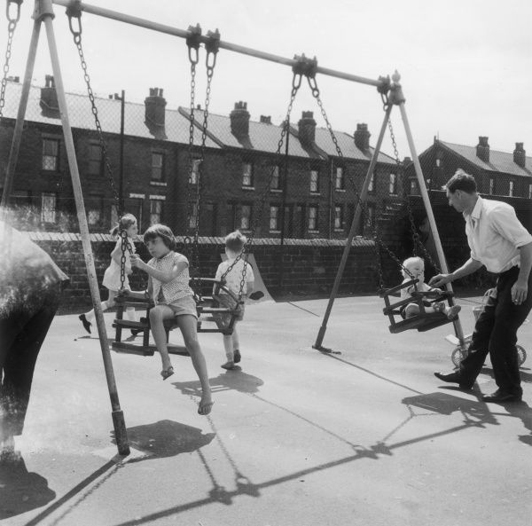 Children on the swings in a Sheffield playground