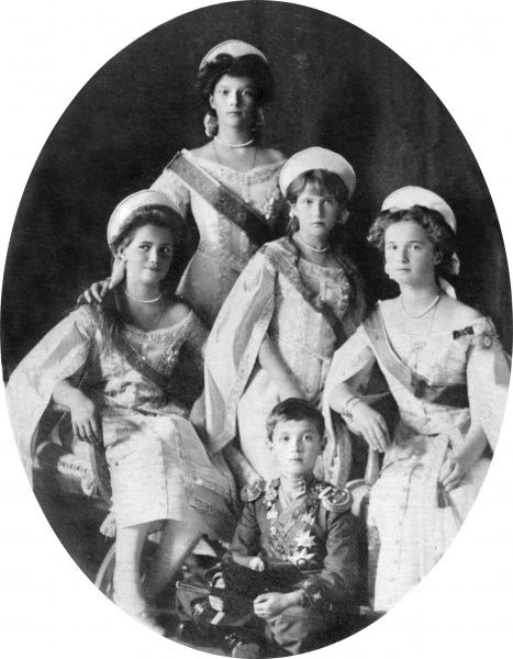 The Russian Imperial children in Court dress in about 1910; the Tsesarevich Alexei is centre and his sisters, from left are: Marie, Tatiana, Anastasia and Olga
