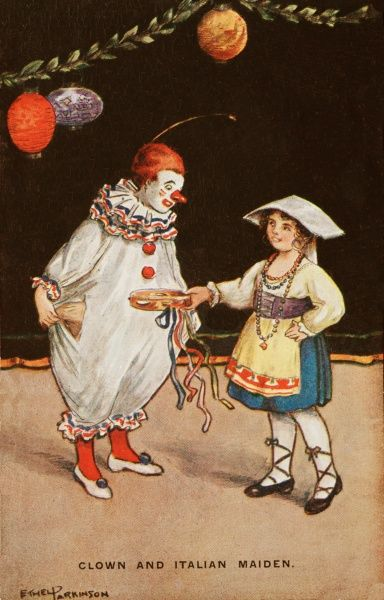 Two children in costume for a fancy dress party. A large boy is dressed as a clown, while a little girl has come as an Italian maiden, the latter idea perhaps not so popular these days!