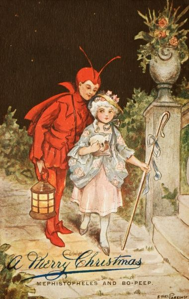 Two children dressed as Mephistopheles and Little Bo-Peep make their way along a garden path to a party, using a lantern to light the way