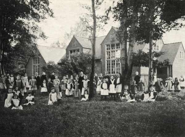 Children and staff outside the Birmingham home for children and orphans run by the National Children's Homes (NCH). Date: circa 1905
