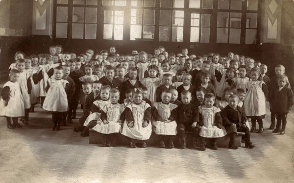 View inside a children's nursery at the cottage homes in Styal, Cheshire, with a large group of girls and boys posing for their photograph. The homes were opened by the Chorlton Union in 1898 to house pauper children away from the workhouse