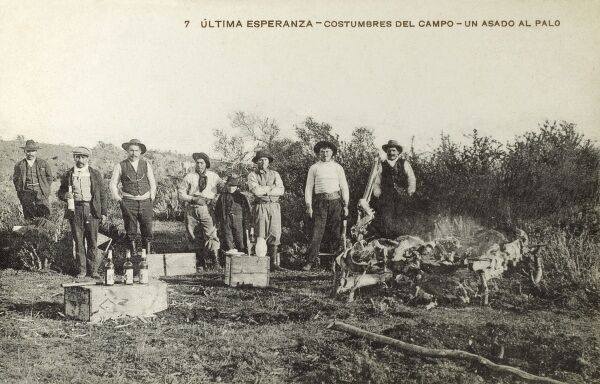 The customs of the agricultural labourers in Chile - a temporary camp where the men are spit-roasting meat and drinking Chilean wine. Date: circa 1910