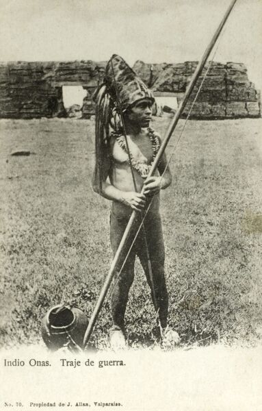 Chile - Tierra del Fuego - Onas Indian Warrior in full battle dress Date: circa 1910s