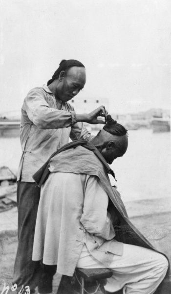 In a Chinese barbershop, 'short back and sides' is taken literally.  circa 1911