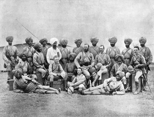 Members of the Chitral Expedition, including Lieut. Cheyne, Capt. C.R Ross, Major Sawyer, Capt. Gordon, Lieut. Henderson and a Sikh priest. 14th Ferozepore Sikhs. Date: April 13 1895