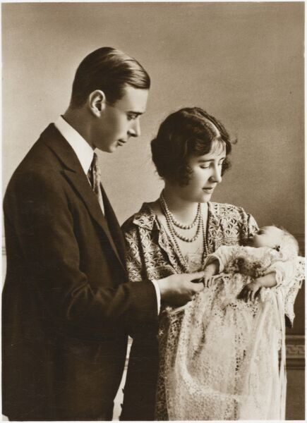 Official photograph of baby Princess Elizabeth (later Queen Elizabeth II) with her parents King George VI and Queen Elizabeth (later the Queen Mother) at Buckingham Palace on 19th May, 1926 on the day of the Princess' Christening