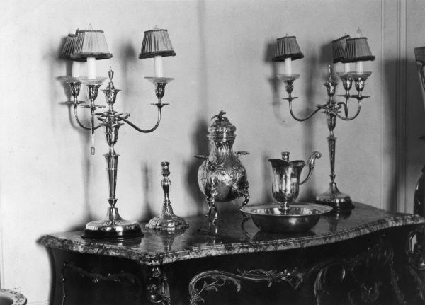 Silver candelabras and candlesticks, also Russian samovar and silver dish with ewer, used at the christening of King Christian IX (father of Queen Alexandra), 1818. Date: 1930s