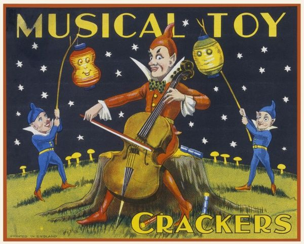 Label from a box of musical toy crackers featuring a cello playing pixie flanked by two smaller pixies holding Chinese paper lanterns against starry sky