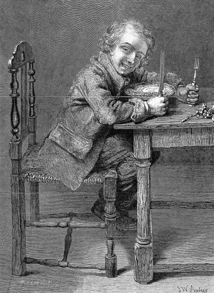 Grinning young man or boy sitting at a table with knife and fork in readiness to eat a Christmas Pie