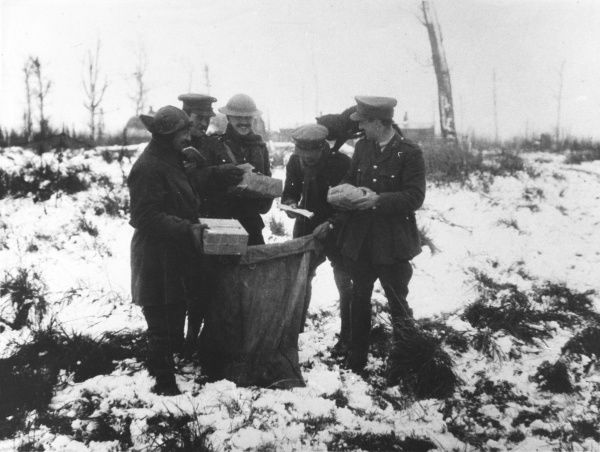 Christmas letters and parcels from home are cheerfully received by soldiers at the front line on the Western Front