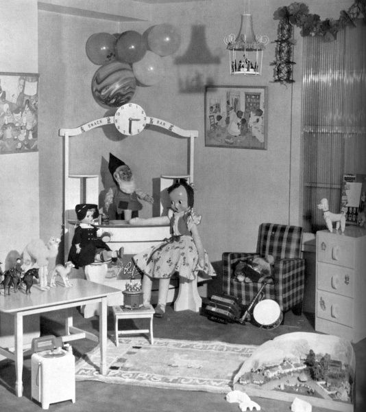 An array of wonderful toys for potential Christmas presents in 1953 including a farm set, a large dancing doll (slightly sinister), a nursery rug decorated with a rabbit, a toy snack bar, a musical hurly burly, a drum and a washing machine. Date