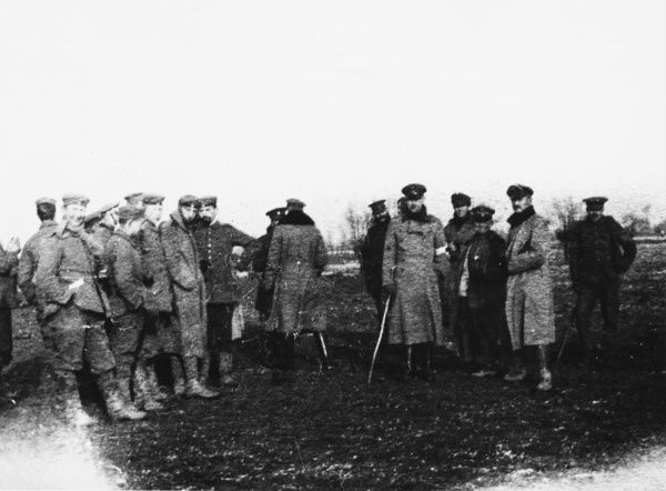 British and German soldiers meeting in No Mans land during an unoffical truce at Christmas. British troops included the Northumberland Hussars, 7th Division in the Bridoux-Bancs sector during World War I