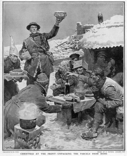 A group of British soldiers share the contents of a hamper which has been delivered to them at the Front. A Christmas pudding is held aloft and the scene is of general jollity