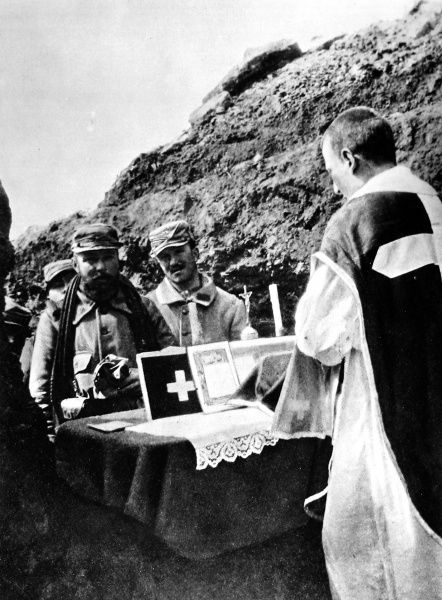 A French soldier-priest ministering to his comrades under fire