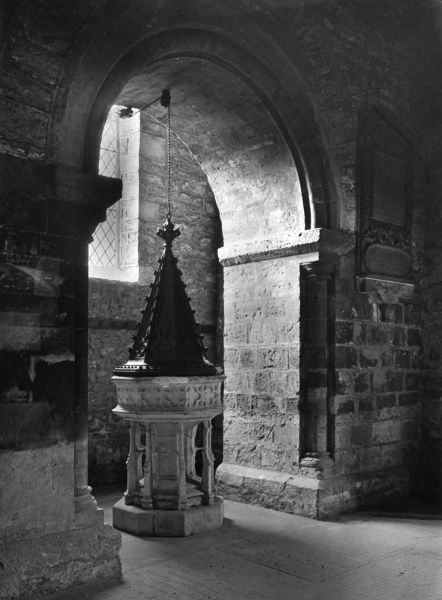 The old font in the parish church at Chepstow, Monmouthshire, Wales. Date: 11th - 12th century