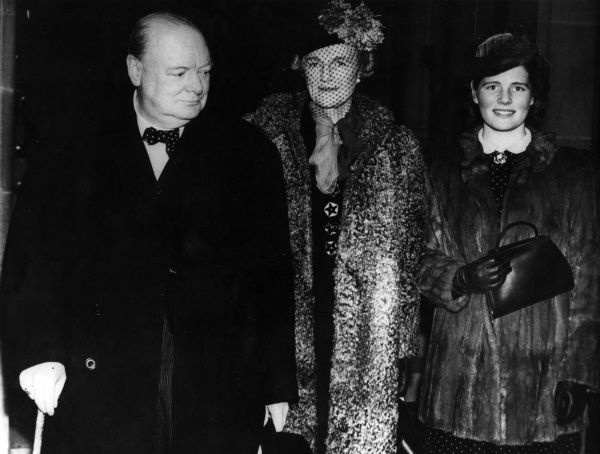Winston Churchill arriving at the Free Trade Hall, Manchester, with his wife Clementine and his youngest daughter Mary(later Baroness Soames)in January 1940. Date: January 1940