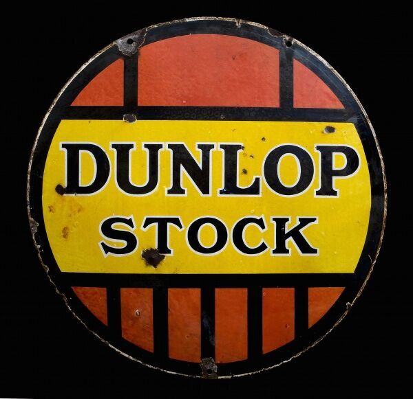 A round enamel sign advertising Dunlop Stock. *EDITORIAL USE ONLY*