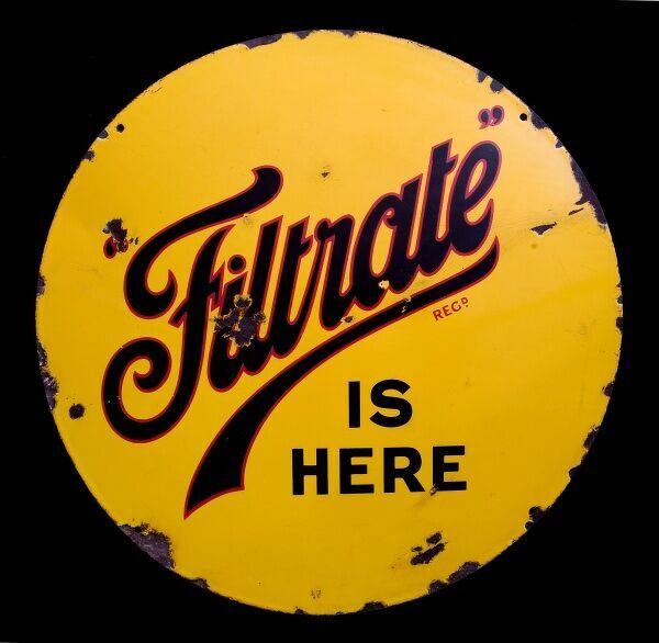 A round enamel sign advertising Filtrate. *EDITORIAL USE ONLY*