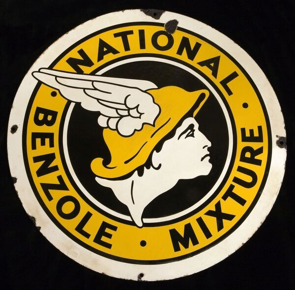 A round enamel sign advertising National Benzole Mixture, with the distinctive logo emblem of the head of the winged messenger God Mercury. *EDITORIAL USE ONLY*