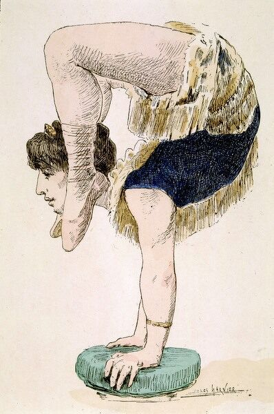 A female acrobat balances on her hands and brings her ankles level with her ears