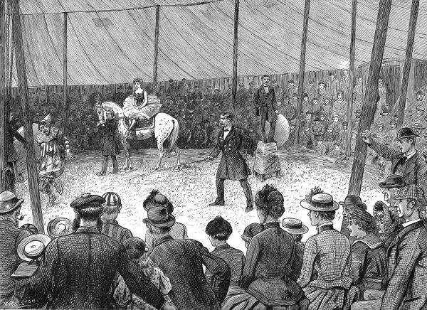 Engraving showing a performance under way, during a travelling circus' visit to an English country town, c.1886. The audience look on, amused, as the ring-master delivers a lash to the clown with his whip