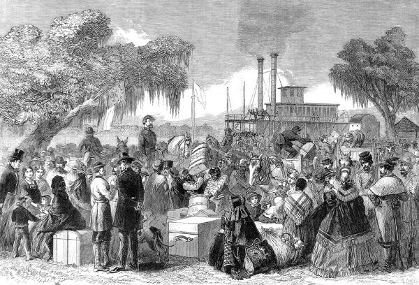 Arrival of a Federal steamer, with flag of truce at Madisonville, Lake Portchartrain. The scene shows men, women, children and black servants with boxes and travelling bags waiting for the steamer
