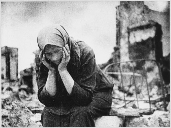 CIVILIAN SCENES Homeless Russian refugee amidst the ruins