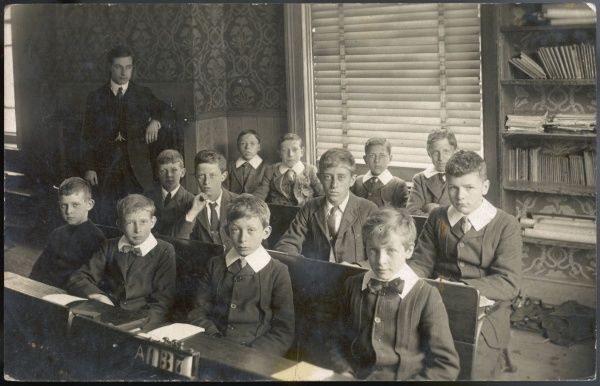 A small class of boys with their teacher at a school in North London -- it appears to be a private school