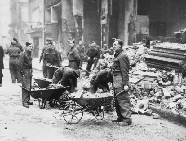 Clearing rubble from bombed buildings in London during the Blitz - 1940