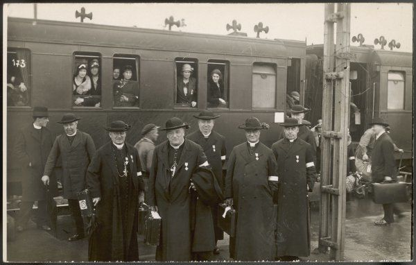 Clerical pilgrims arrive at the railway station - note the facial expressions!