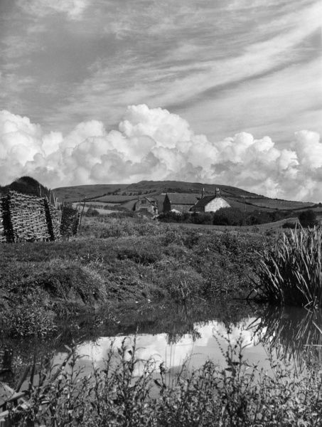 An impressive cloud formation over the countryside near Childeock, Dorset, England. Date: 1950s