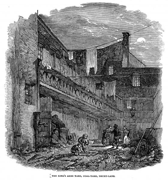 Concern over the outbreak of Cholera highlighted this scene at night in the coal yard of The King's Arms Yard in Drury Lane. Here around 17 large families live in small apartments above sheds for animals. Sometimes many cartloads of refuse lie in the yard