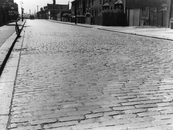 A granite cobbled street. Date: 1950s