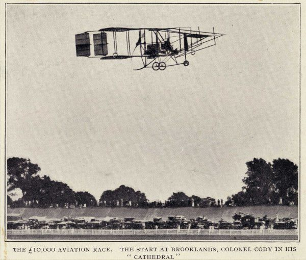 "The 10,000 aviation race. The start at Brooklands, Colonel Cody in his aeroplane ""Cathedral"".&quot"