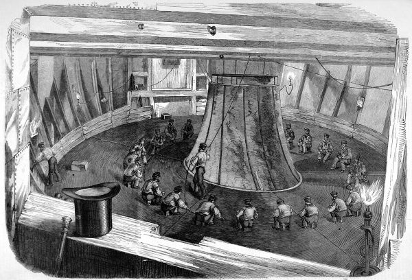 Coiling of the Atlantic cable on board H.M.S 'Agamemnon' prior to the 1858 expedition to lay cable from Britain to North America. The cable was successfully laid on 5th August 1858, but the connection was lost on 20th October. Despite this