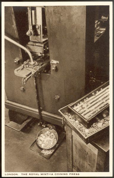 A close-up view of a coining press