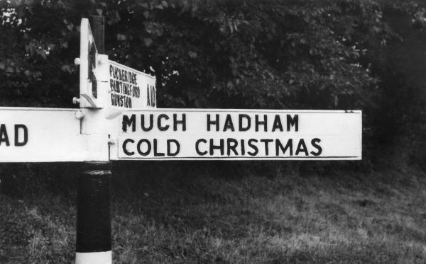 An amusing signpost for the villages of 'Much Hadham' and 'Cold Christmas' in Hertfordshire, England! Date: 1950s