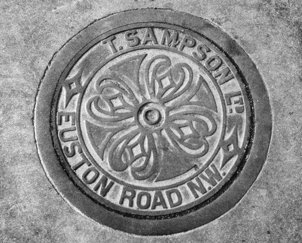 A cast iron coal hole cover. Date: 1960s