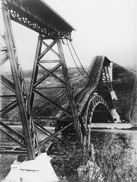 The wreck of a railway bridge in Poland, destroyed by retreating German forces on the Eastern Front