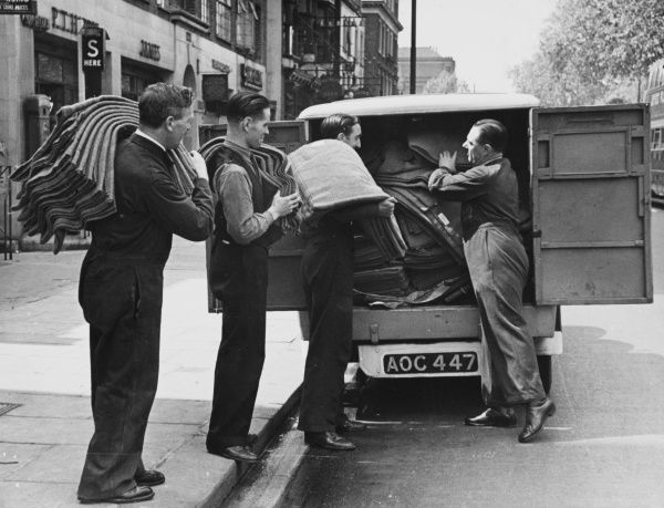 Blankets are collected by van to be used in refugee billets in England during World War II