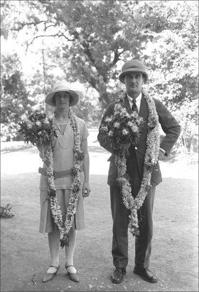 Colonel Ralph Ponsonby Watts (1892 - 1991) & his wife decked out in floral garlands on an official visit. Photograph by Ralph Ponsonby Watts