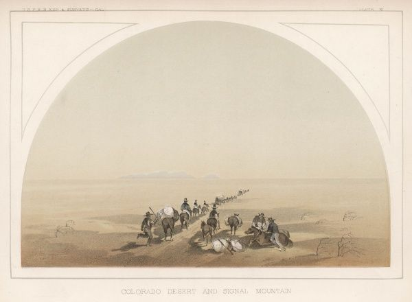 A government exploring party saddle up their mules before crossing the Colorado Desert towards Signal Mountain, a vivid depiction of the American desert landscape
